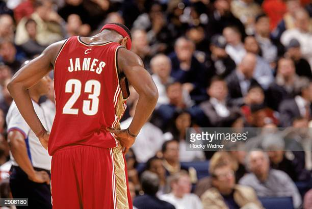 LeBron James of the Cleveland Cavaliers hangs his head during a break in game action against the Golden State Warriors on January 15 2004 at the...