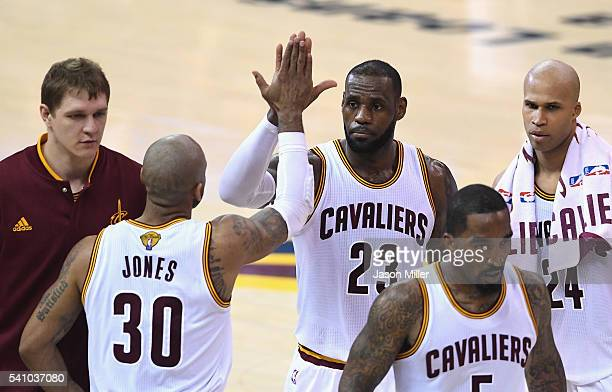 LeBron James of the Cleveland Cavaliers high fives Dahntay Jones in Game 6 of the 2016 NBA Finals against the Golden State Warriors at Quicken Loans...