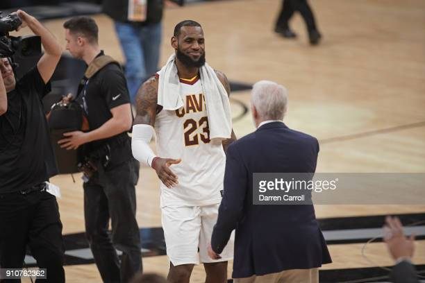 LeBron James of the Cleveland Cavaliers high fives Gregg Popovich of the San Antonio Spurs on January 23 2018 at the ATT Center in San Antonio Texas...