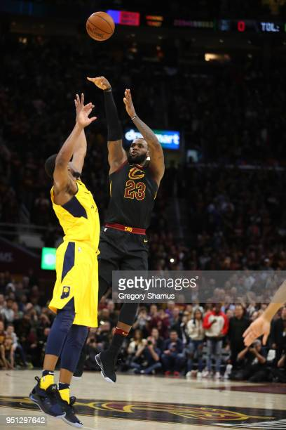 LeBron James of the Cleveland Cavaliers hits the game winning shot over Thaddeus Young of the Indiana Pacers to win Game Five of the Eastern...