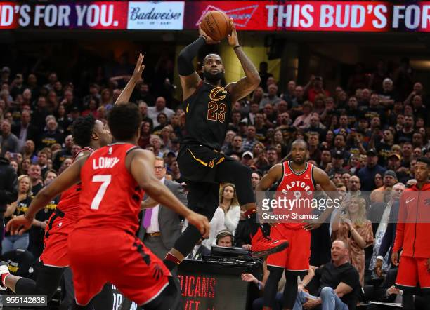 LeBron James of the Cleveland Cavaliers hits the game winning shot over the outstretched hand of OG Anunoby of the Toronto Raptors to win Game Three...