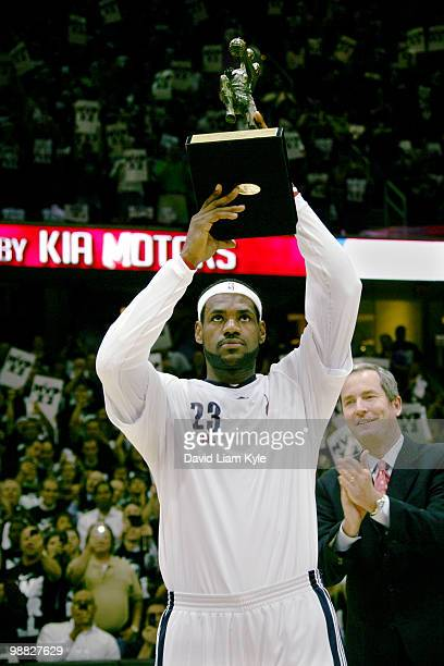 LeBron James of the Cleveland Cavaliers hoists the Maurice Podoloff Trophy as the 200910 NBA Most Valuable Player presented by Kia Motors before the...