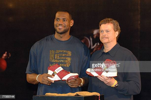 LeBron James of the Cleveland Cavaliers holds his new Nike shoe with Nike President and CEO Mark Parker during an appearance as part of the 2007 NBA...