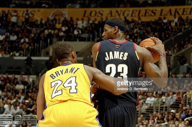 LeBron James of the Cleveland Cavaliers holds the ball against Kobe Bryant of the Los Angeles Lakers on February 15, 2007 at Staples Center in Los...