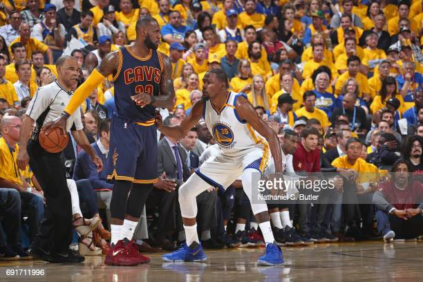 LeBron James of the Cleveland Cavaliers holds the ball away from Kevin Durant of the Golden State Warriors in Game One of the 2017 NBA Finals on June...