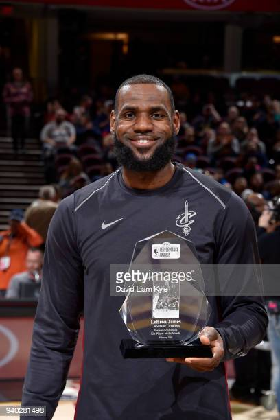LeBron James of the Cleveland Cavaliers holds the KIA player of the Month award prior to the game against the New Orleans Pelicans on March 30 2018...