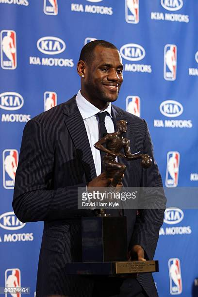 LeBron James of the Cleveland Cavaliers holds the trophy for NBA 200809 Most Valuable Player at St VincentSt Mary's High School on May 4 2009 in...