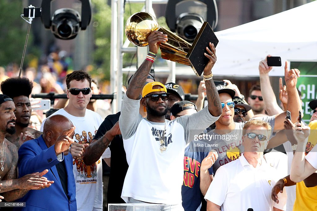 LeBron James #23 of the Cleveland Cavaliers holds up the Larry O'Brien Trophy during the Cleveland Cavaliers 2016 NBA Championship victory parade and rally on June 22, 2016 in Cleveland, Ohio.