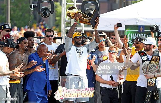 LeBron James of the Cleveland Cavaliers holds up the Larry O'Brien Trophy during the Cleveland Cavaliers 2016 NBA Championship victory parade and...