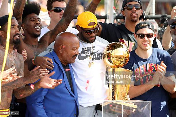 LeBron James of the Cleveland Cavaliers holds up the Larry O'Brien Trophywith former Cleveland Brown and NFL Hall of Famer Jim Brown during the...