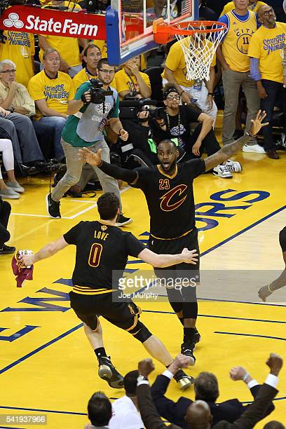 LeBron James of the Cleveland Cavaliers hugs Kevin Love after defeating the Golden State Warriors during Game Seven of the 2016 NBA Finals on June 19...