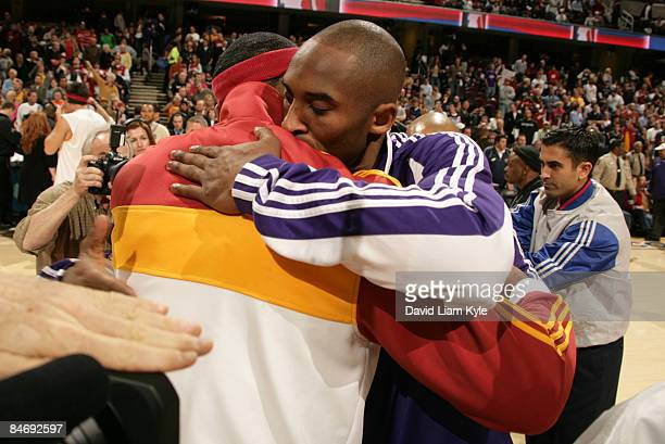LeBron James of the Cleveland Cavaliers hugs Kobe Bryant of the Los Angeles Lakers prior to the start of the game at The Quicken Loans Arena on...