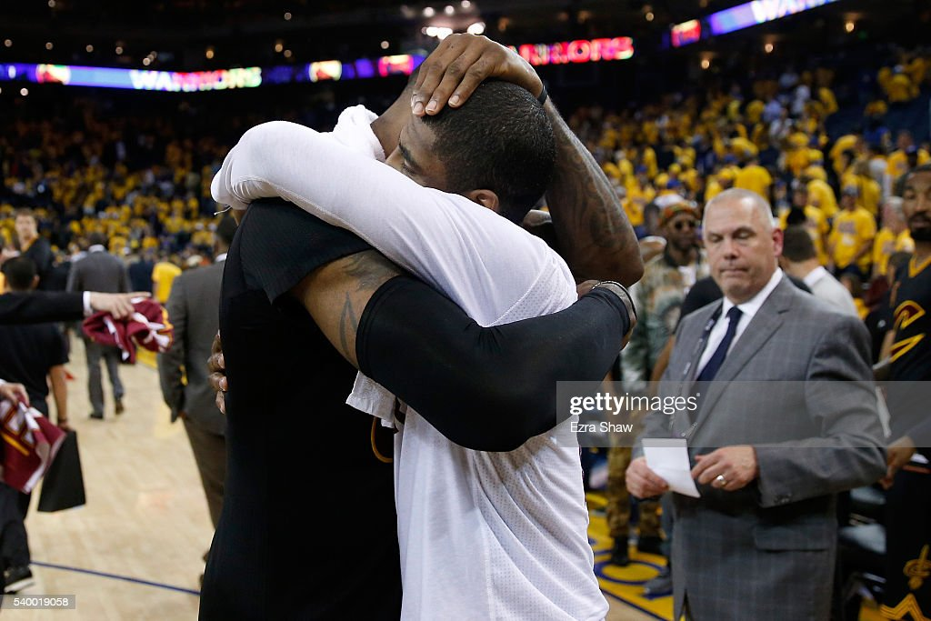 LeBron James #23 of the Cleveland Cavaliers hugs teammate Kyrie Irving #2 after defeating the Golden State Warriors in Game 5 of the 2016 NBA Finals with a score of 112 to 97 at ORACLE Arena on June 13, 2016 in Oakland, California.