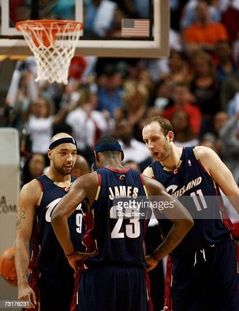 LeBron James of the Cleveland Cavaliers is consoled by teammates Drew Gooden and Zydrunas Ilgauskas after missing his third straight free-throw late...