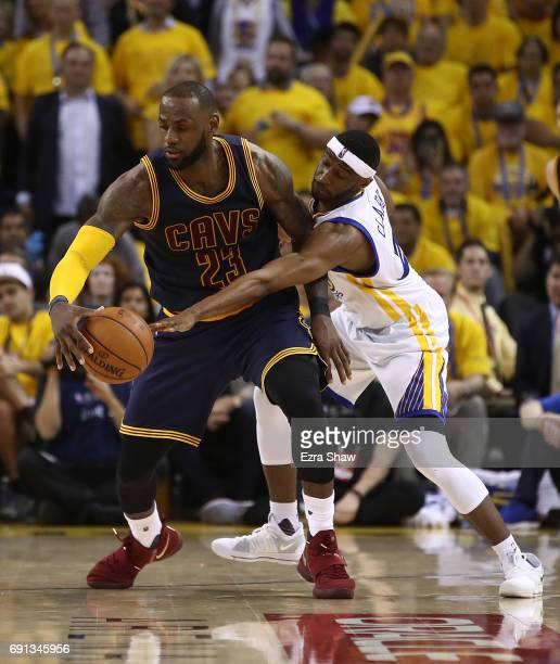 LeBron James of the Cleveland Cavaliers is defended by Ian Clark of the Golden State Warriors in Game 1 of the 2017 NBA Finals at ORACLE Arena on...