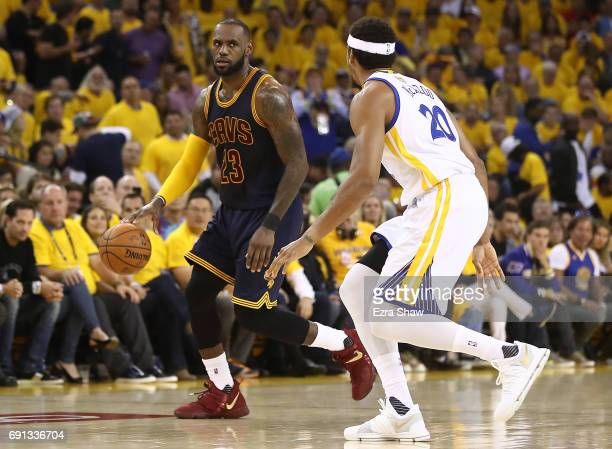 LeBron James of the Cleveland Cavaliers is defended by James Michael McAdoo of the Golden State Warriors during the first half of Game 1 of the 2017...