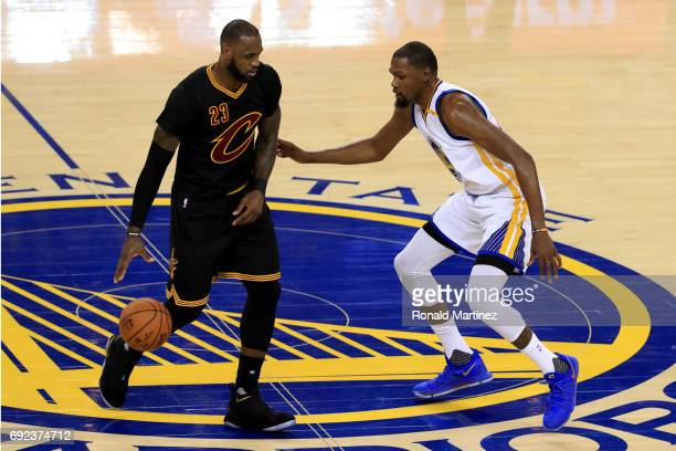 LeBron James of the Cleveland Cavaliers is defended by Kevin Durant of the Golden State Warriors during the second half of Game 2 of the 2017 NBA...