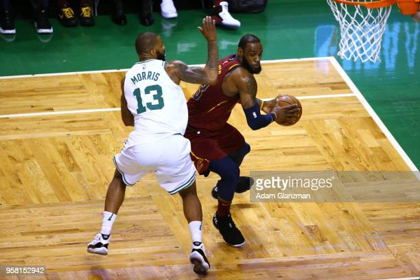 LeBron James of the Cleveland Cavaliers is defended by Marcus Morris of the Boston Celtics during the first quarter in Game One of the Eastern...