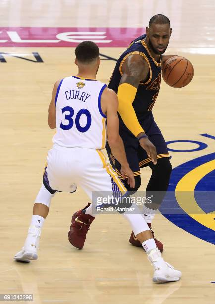 LeBron James of the Cleveland Cavaliers is defended by Stephen Curry of the Golden State Warriors during the second half of Game 1 of the 2017 NBA...