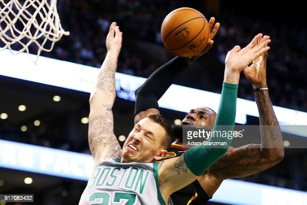Lebron James of the Cleveland Cavaliers is fouled as he drives to the basket by Daniel Theis of the Boston Celtics during a game at TD Garden on...