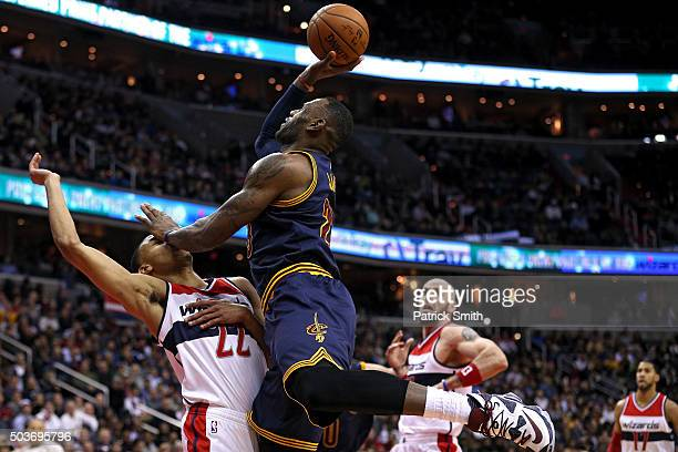 LeBron James of the Cleveland Cavaliers is fouled by Otto Porter Jr #22 of the Washington Wizards during the first half at Verizon Center on January...