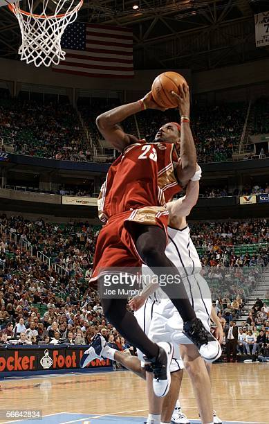 Lebron James of the Cleveland Cavaliers is fouled on his way to the basket during a game between the Cleveland Cavaliers and Utah Jazz January 21...