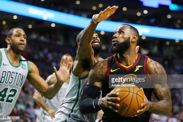 Lebron James of the Cleveland Cavaliers is guarded by Kyrie Irving of the Boston Celtics during the first quarter of a game at TD Garden on February...