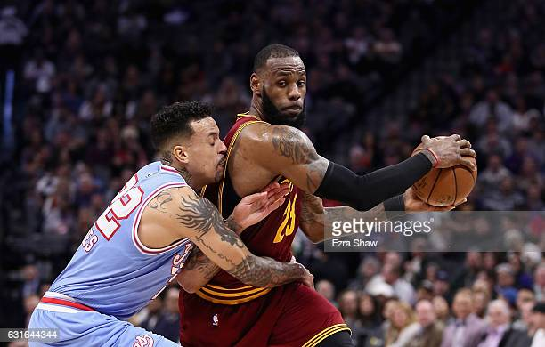 LeBron James of the Cleveland Cavaliers is guarded by Matt Barnes of the Sacramento Kings at Golden 1 Center on January 13 2017 in Sacramento...