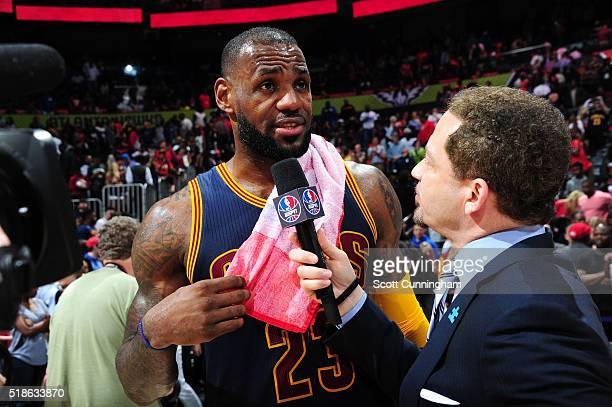 LeBron James of the Cleveland Cavaliers is interviewed after the game against the Atlanta Hawks on April 1 2016 at Philips Arena in Atlanta Georgia...