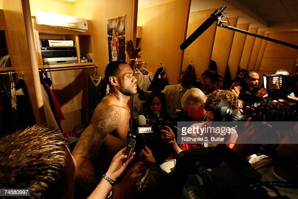 LeBron James of the Cleveland Cavaliers is interviewed in front of his locker prior to Game Three of the NBA Finals against the San Antonio Spurs at...