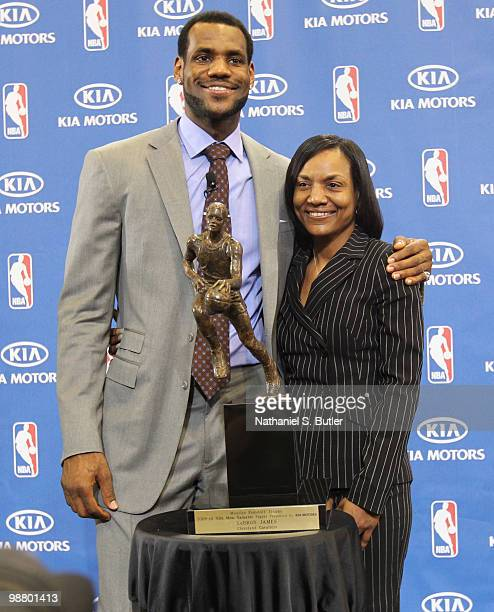 LeBron James of the Cleveland Cavaliers is joined by his mother Gloria James as he receives the Maurice Podoloff Trophy as the 200910 NBA Most...