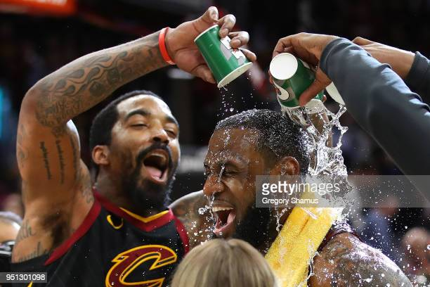 LeBron James of the Cleveland Cavaliers is showered with water by JR Smith while being interviewed after a 98-95 win over the Indiana Pacers in Game...