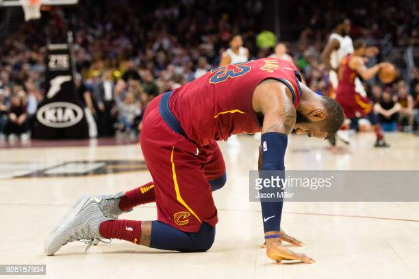 LeBron James of the Cleveland Cavaliers is slow getting up after being hit in the face during the second half against the Brooklyn Nets at Quicken...