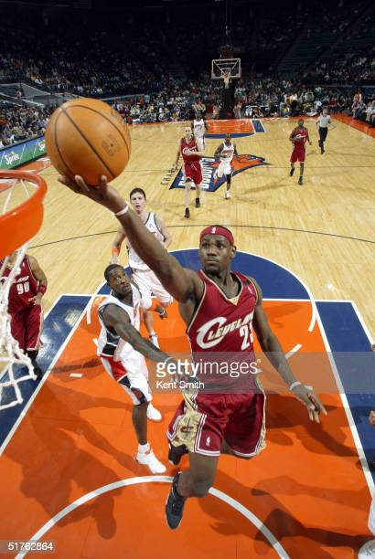 LeBron James of the Cleveland Cavaliers jumps to the basket against Gerald Wallace of the Charlotte Bobcats during the NBA game on November 18, 2004...