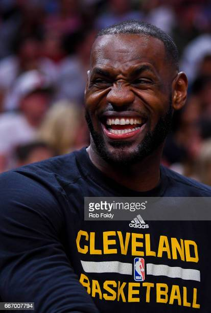 LeBron James of the Cleveland Cavaliers laughs from the bench during the first half of the game against the Miami Heat at the American Airlines Arena...