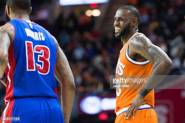 LeBron James of the Cleveland Cavaliers laughs with Marcus Morris of the Detroit Pistons during the second half at Quicken Loans Arena on March 14...
