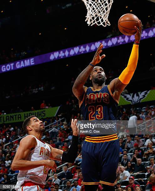 LeBron James of the Cleveland Cavaliers lays in a basket against Thabo Sefolosha of the Atlanta Hawks in Game Four of the Eastern Conference...