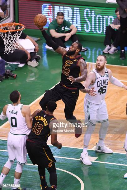 LeBron James of the Cleveland Cavaliers lays up a shot against Aron Baynes of the Boston Celtics during Game Five of the 2018 NBA Eastern Conference...