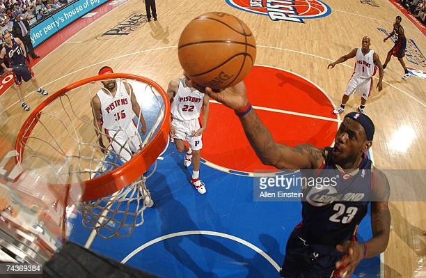 LeBron James of the Cleveland Cavaliers lays up past Tayshaun Prince and Rasheed Wallace of the Detroit Pistons in Game Five of the Eastern...