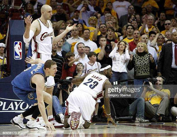 LeBron James of the Cleveland Cavaliers looks for a call as time runs out along with Zydrunas Ilgauskas and Darius Songaila of the Washington Wizards...