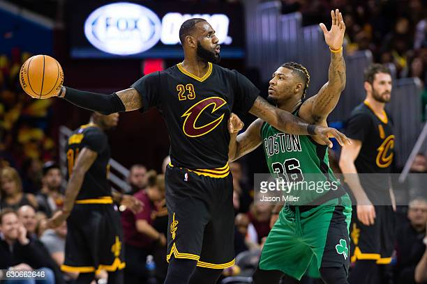 LeBron James of the Cleveland Cavaliers looks for a pass while under pressure from Marcus Smart of the Boston Celtics during the second half at...