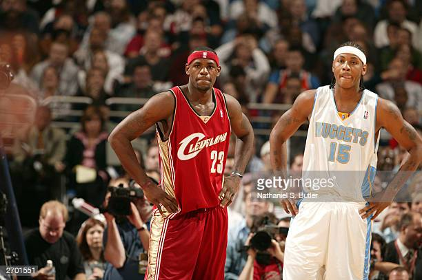 LeBron James of the Cleveland Cavaliers looks looks down court with Carmelo Anthony of the Denver Nuggets November 5 2003 at Gund Arena in Cleveland...