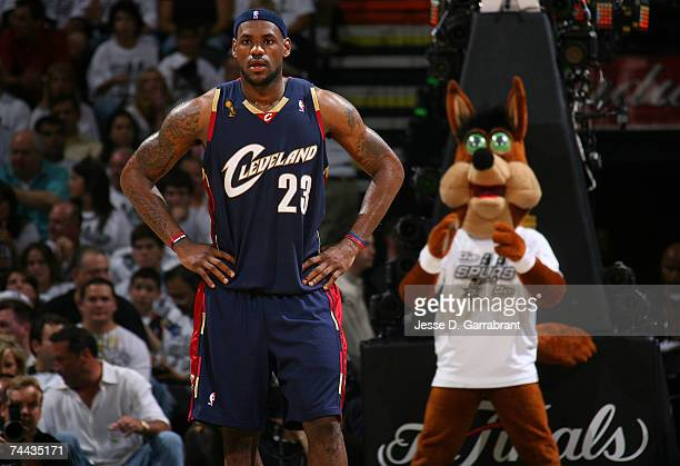 LeBron James of the Cleveland Cavaliers looks on as the Coyotee, the mascot of the San Antonio Spurs stands behind him in Game One of the NBA Finals...