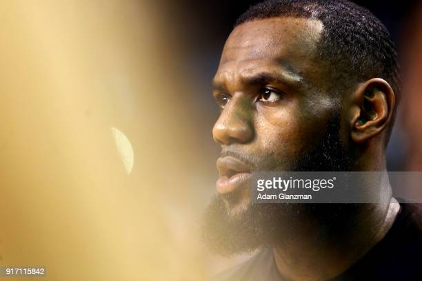 Lebron James of the Cleveland Cavaliers looks on before a game against the Boston Celtics at TD Garden on February 11 2018 in Boston Massachusetts...