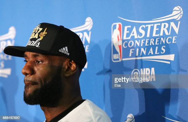 LeBron James of the Cleveland Cavaliers looks on during the trophy presentation after Game Five of the 2017 NBA Eastern Conference Finals at TD...