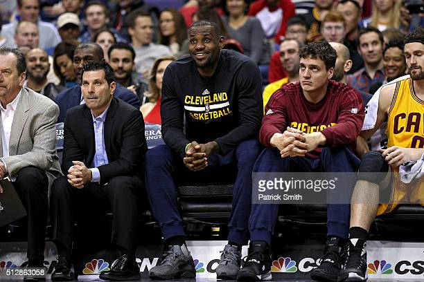 LeBron James of the Cleveland Cavaliers looks on from the bench against the Washington Wizards during the second half at Verizon Center on February...