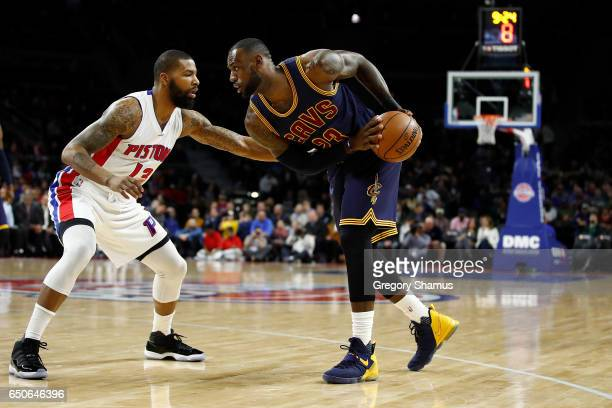 LeBron James of the Cleveland Cavaliers looks to drive to the basket on Marcus Morris of the Detroit Pistons during the first half at the Palace of...