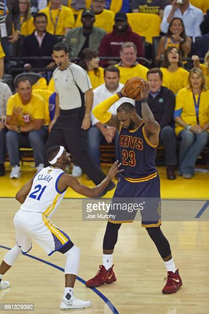 LeBron James of the Cleveland Cavaliers looks to drive to the basket while guarded by Ian Clark of the Golden State Warriors in Game One of the 2017...