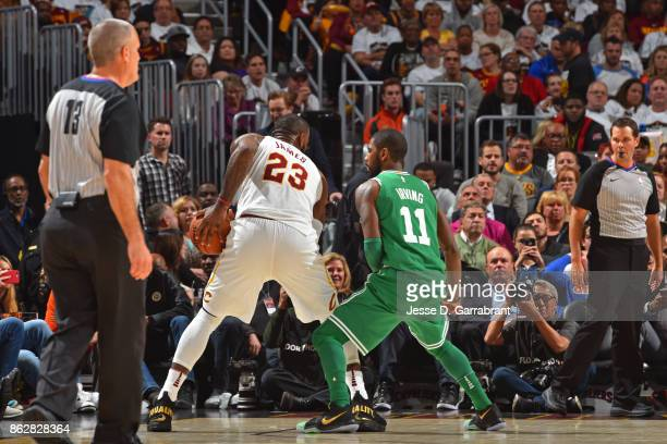 LeBron James of the Cleveland Cavaliers looks to drive to the basket while guarded by Kyrie Irving of the Boston Celtics on October 17 2017 at...