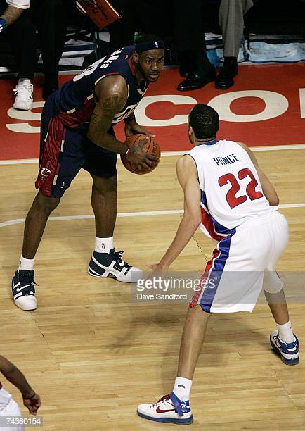LeBron James of the Cleveland Cavaliers looks to move the ball against Tayshaun Prince of the Detroit Pistons in Game One of the Eastern Conference...